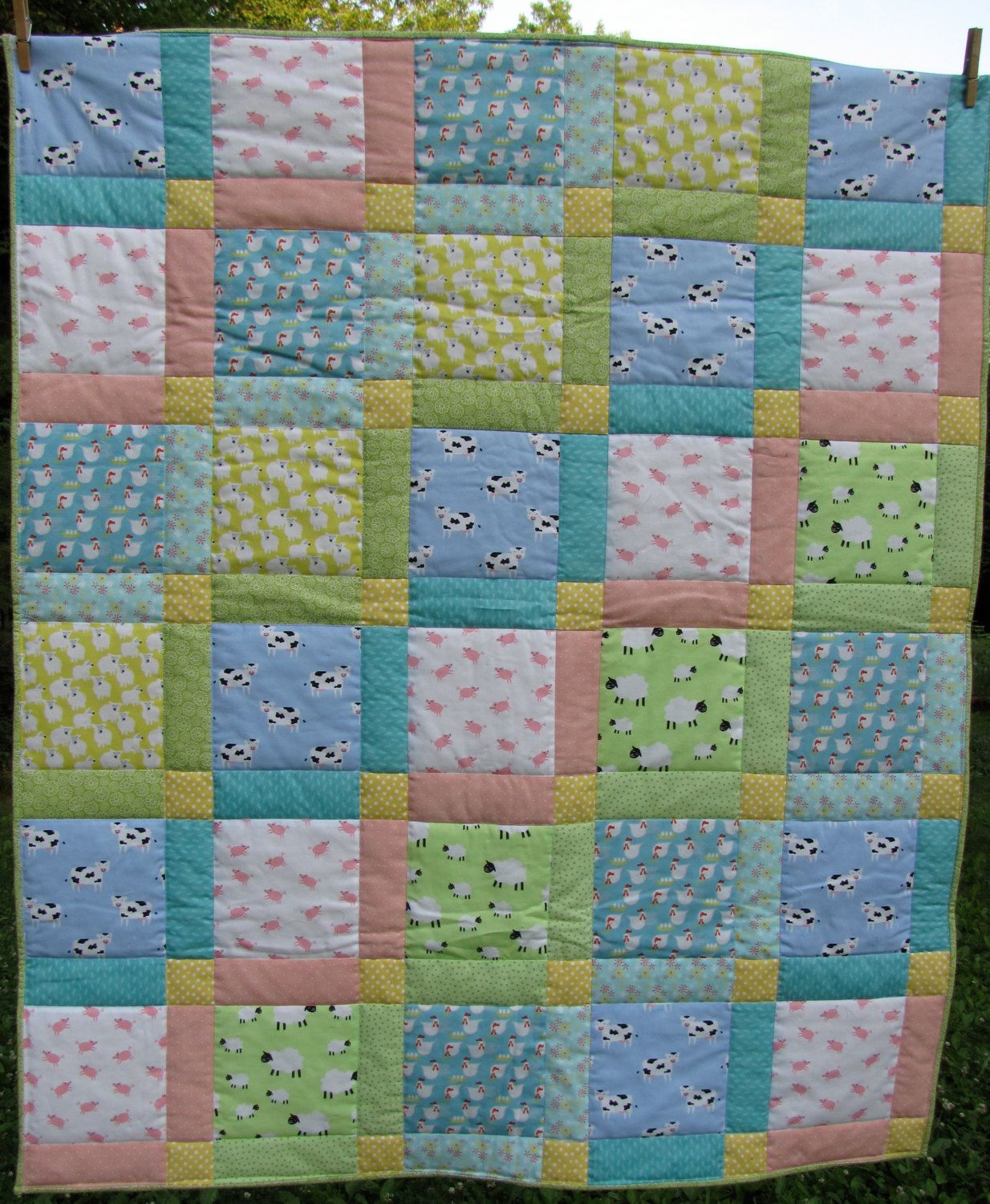 Pastel baby quilt with adorable farm animals, pigs, cows, sheep and chickens. how sweet this would be for a new baby's crib by BlueBeeQuiltsofMaine on Etsy