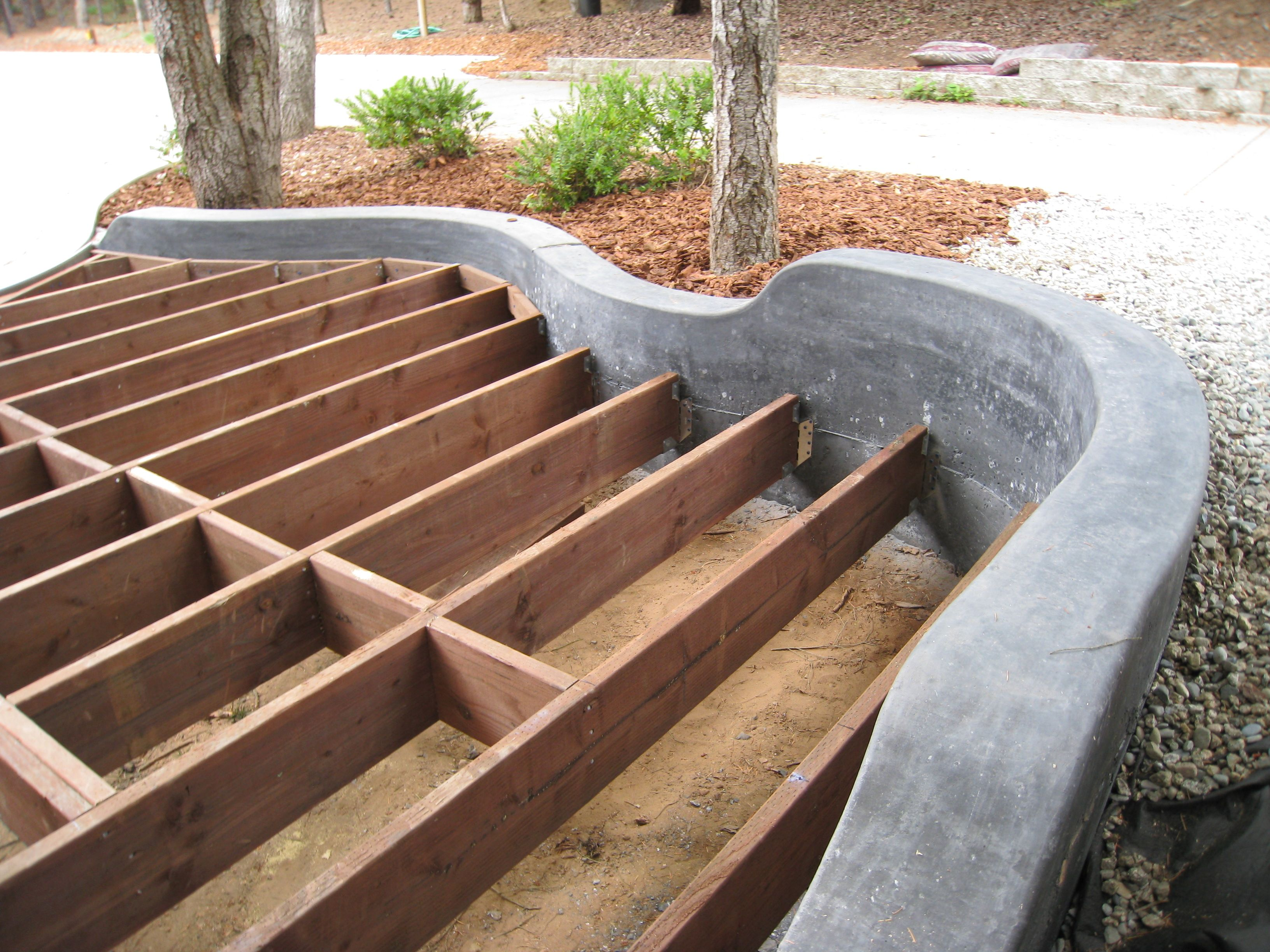Colored concrete retaining wall with deck. by Scott ...