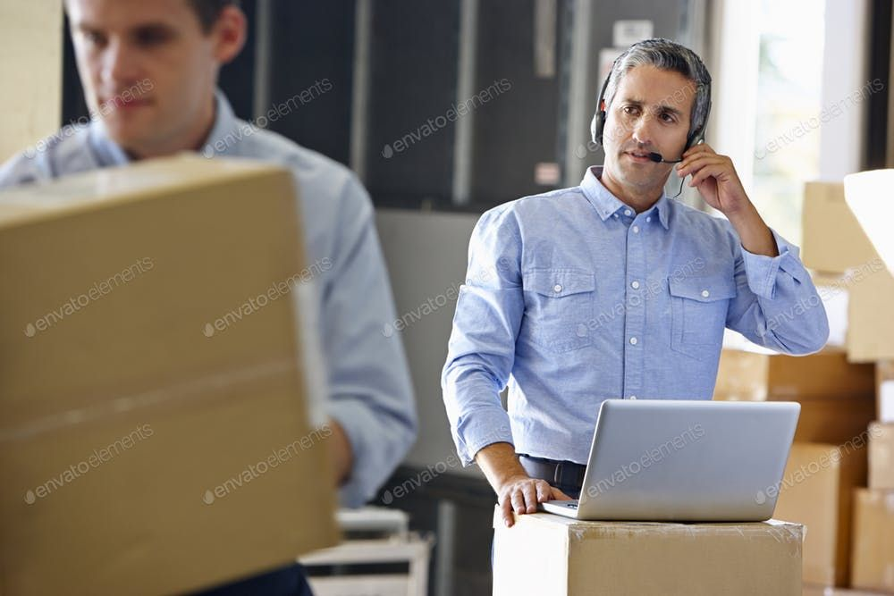 Manager Using Headset In Distribution Warehouse By