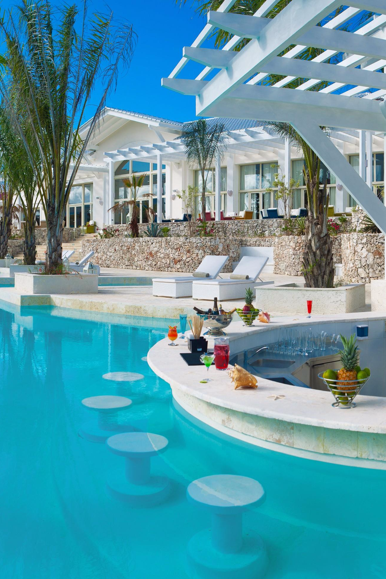 Pony up for a drink at the pool bar. Eden Roc at Cap Cana (Punta ...