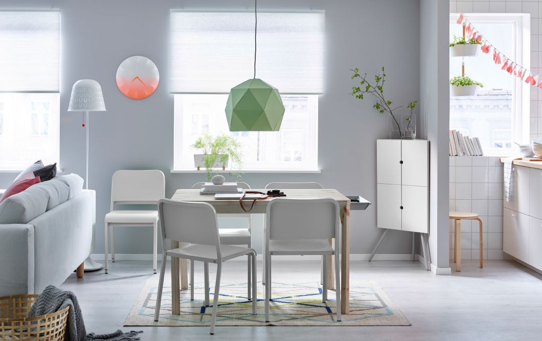A Dining Room With Pine Table And White Chairs Combined Corner Cabinet