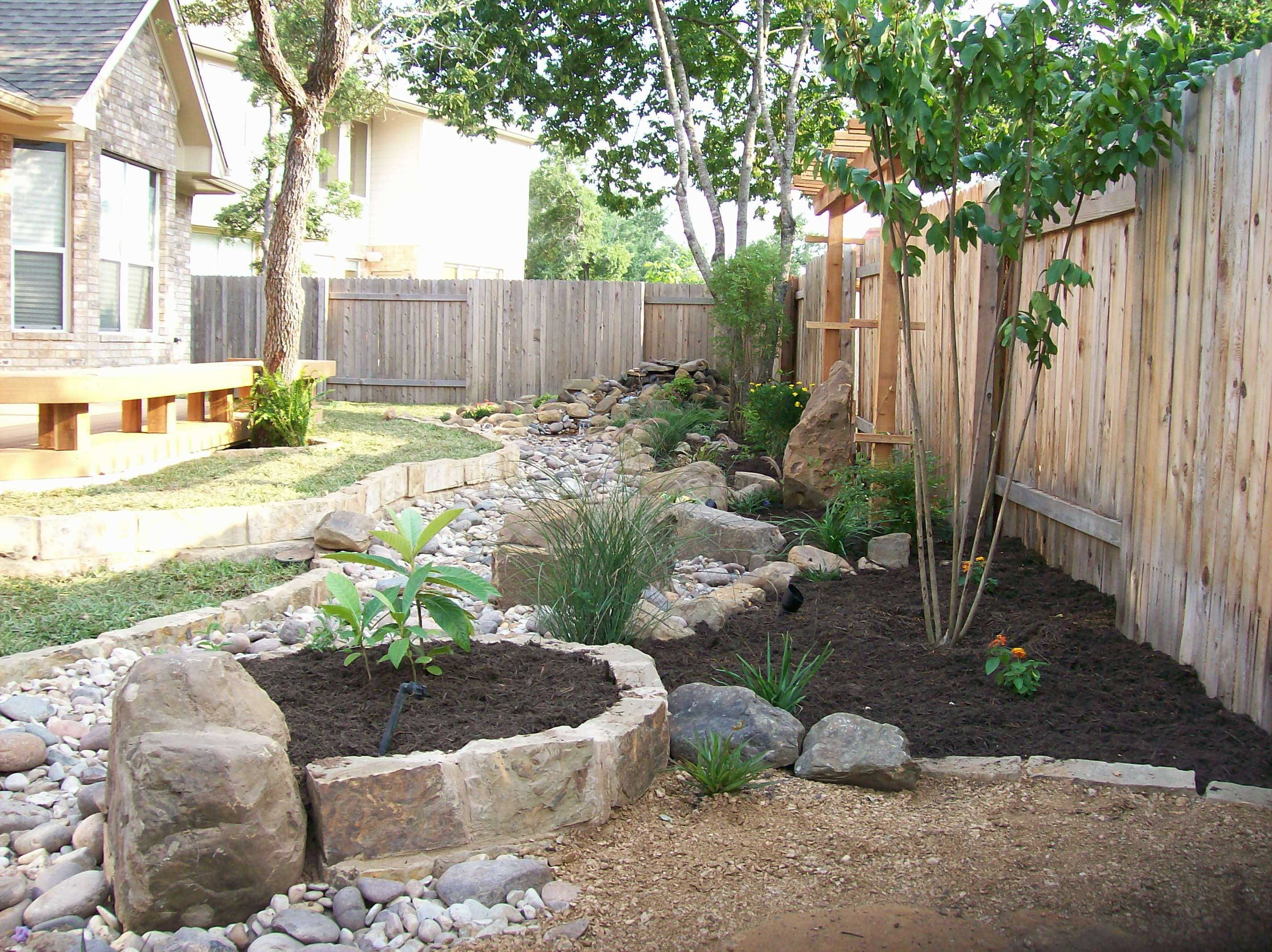 Beautiful dry creek bed with a corner sitting area that ...