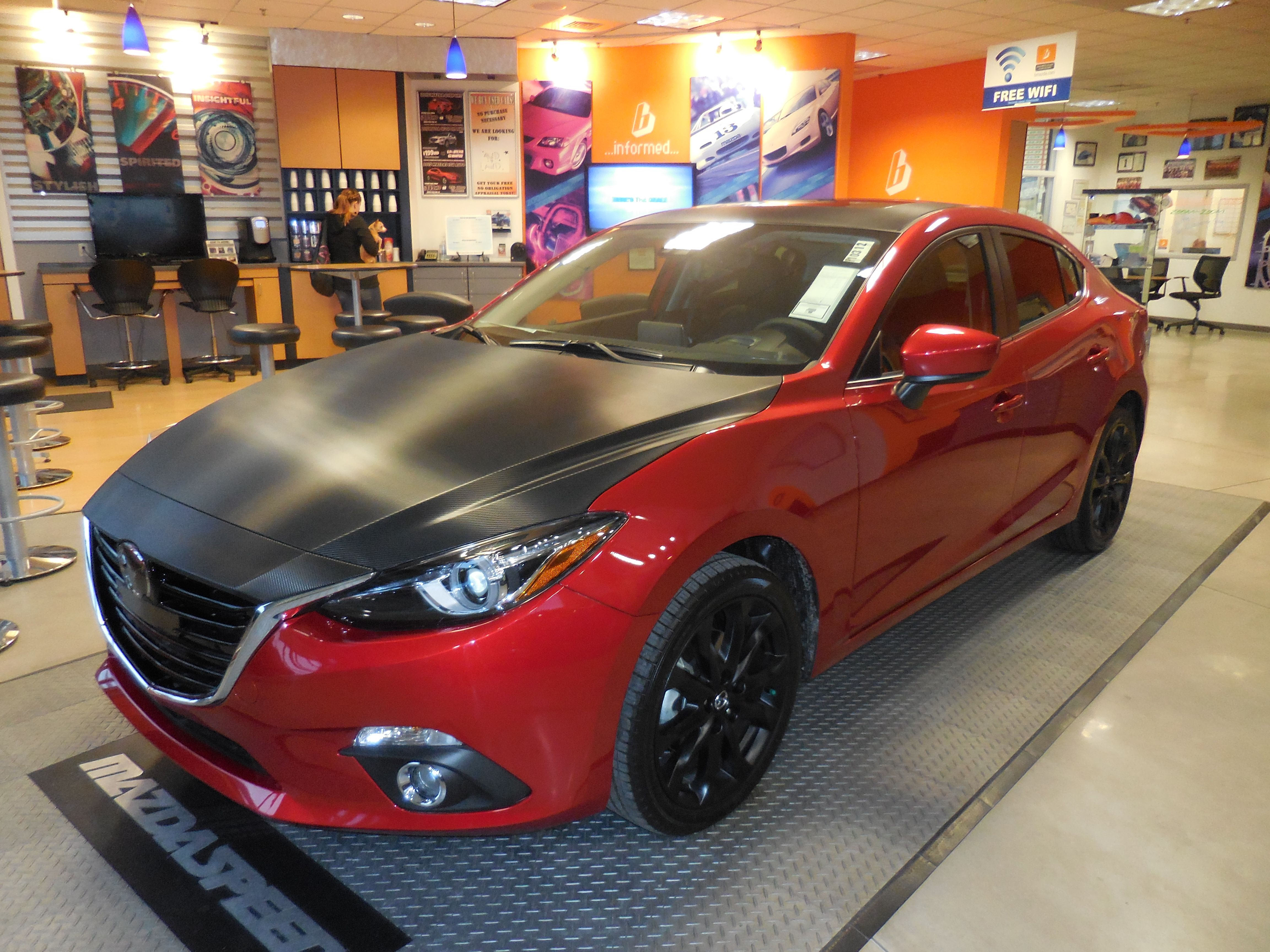 The 2015 mazda3 with carbon fiber hood roof and trunk