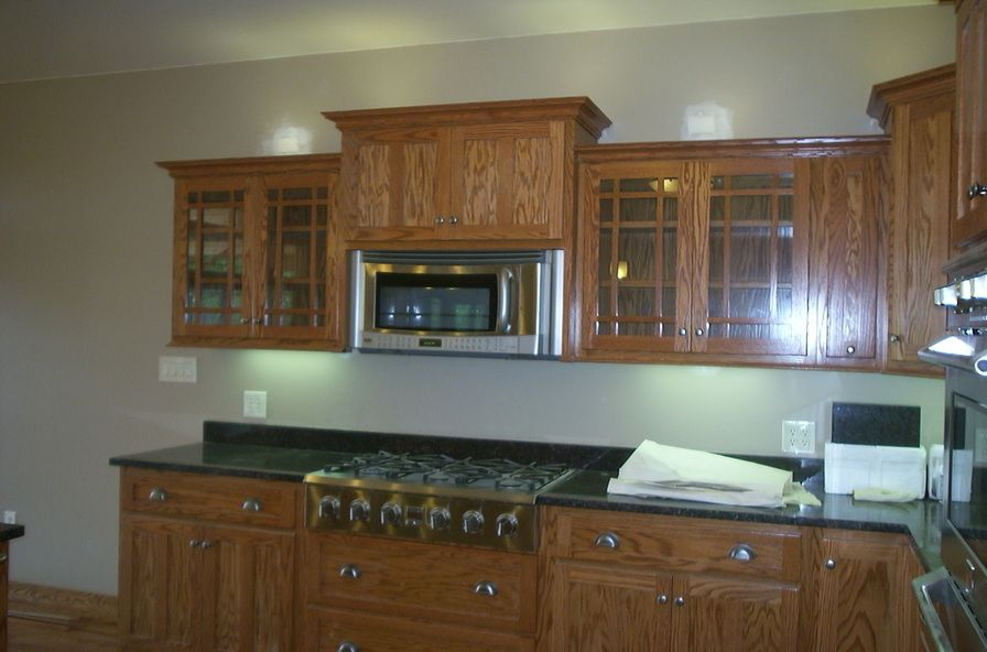 raised microwave flanked by glass cabinets kitchens pinterest rh pinterest com mission style oak kitchen cabinets mission style quarter sawn oak kitchen cabinets