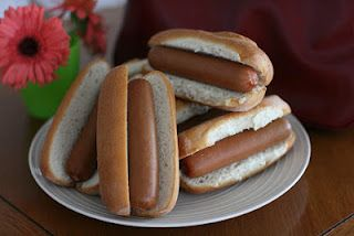 hotdogs for a crowd: 60 will fit in a 6 quart slow cooker, no need to add water (they produce their own liquid), cover and cook on high 2-3 hours or low 4-5!