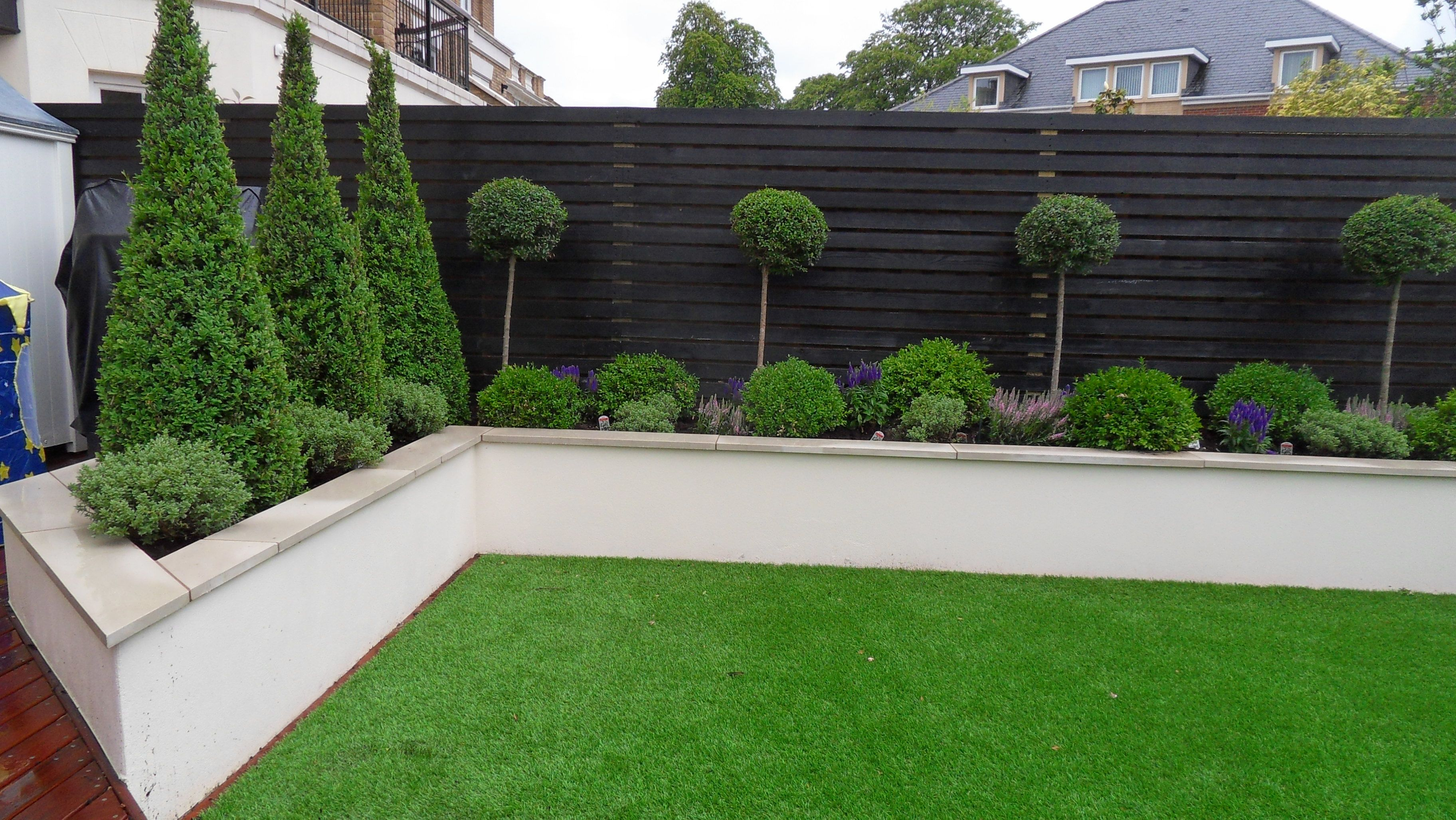 Rendered wall but without capping note colour of wooden for Garden decking colour ideas