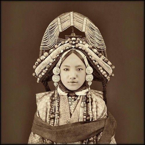 Tibetan princess, circa 1850.  Headdress tells us of her culture.