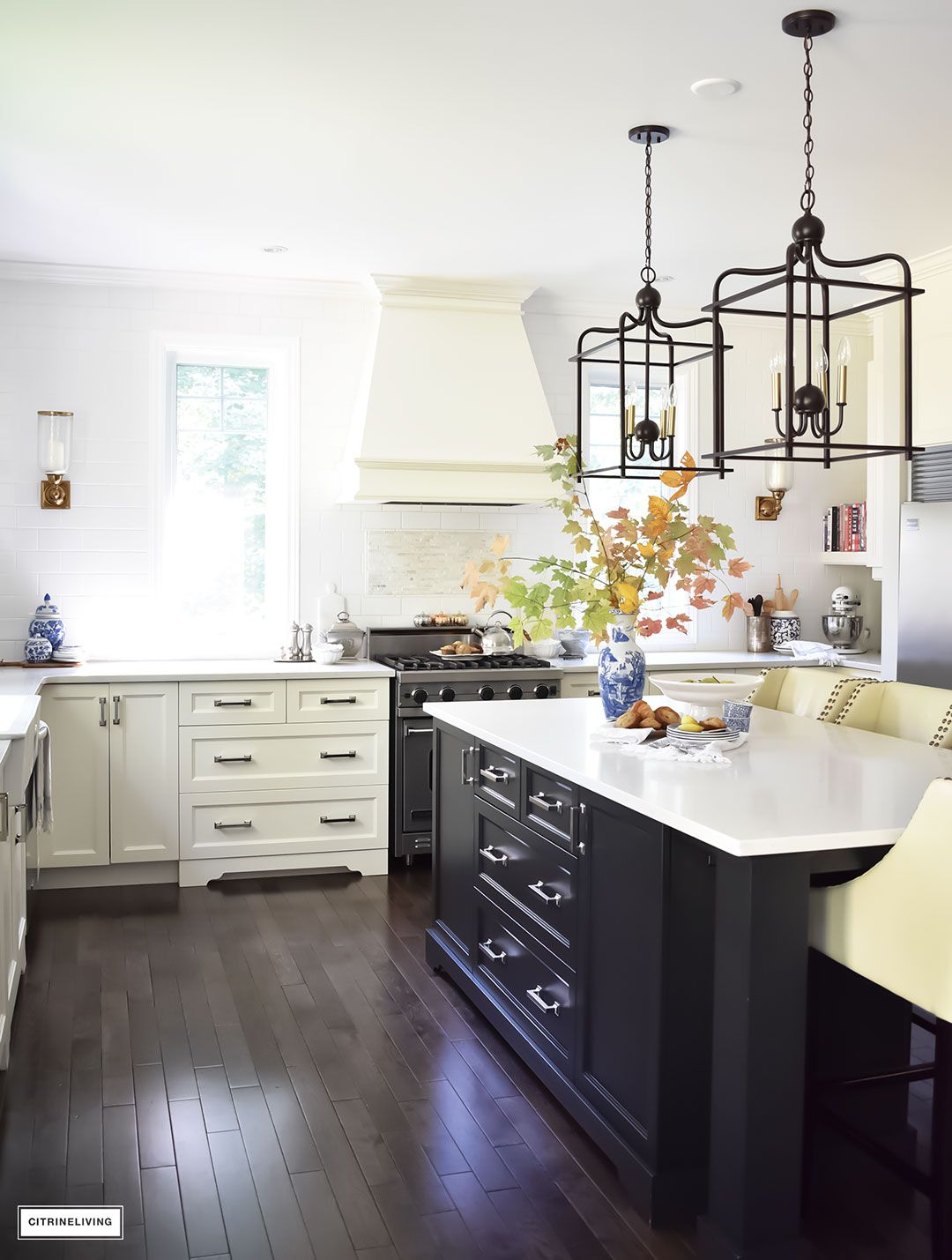 Fall home tour using rich colors brass and gold pinterest white fall home tour casual elegant black and white kitchen with large black island and lantern style pendant lighting blue and white vases and fall foliage aloadofball Choice Image