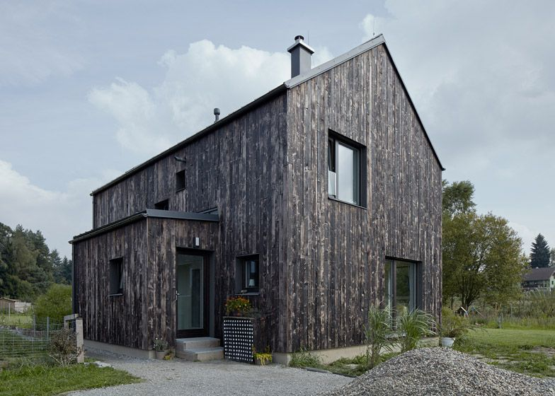 Mjolk Architekti S Carbon House Features A Burnt Wood Exterior