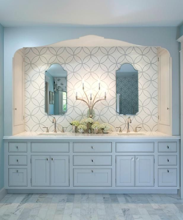 Elegant white bathroom features AKDO Eternity Tiles leading to an