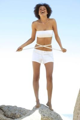 How to Have a Flat Stomach and Thinner Thighs | Livestrong.com