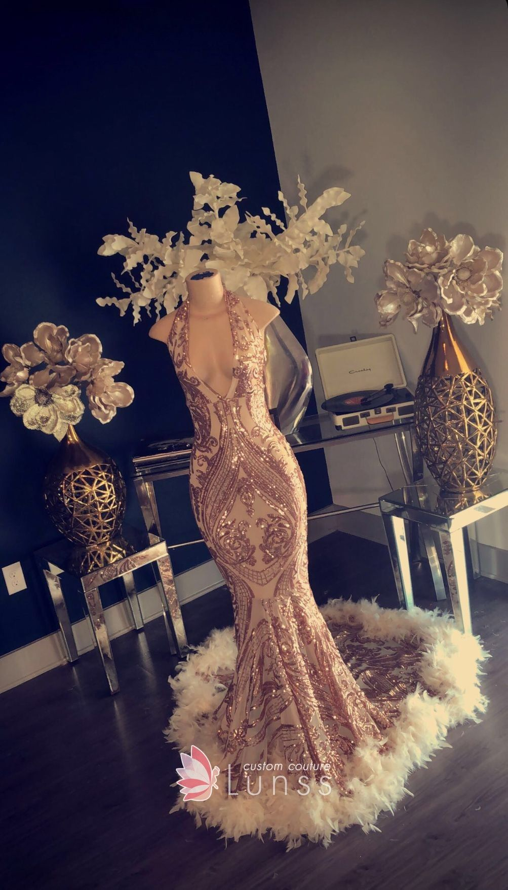 3c9de8ce Sparkly patterned gold sequin floor length mermaid prom gown with long train  and feathers hemline. Halter & plunging neckline.