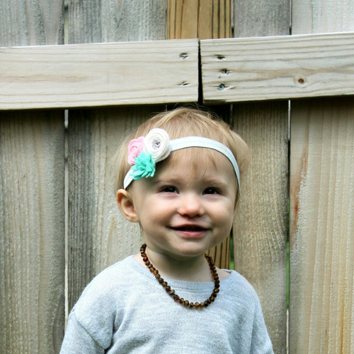 Nora is wearing her felt floral headband and it matches her Mommy's perfectly !