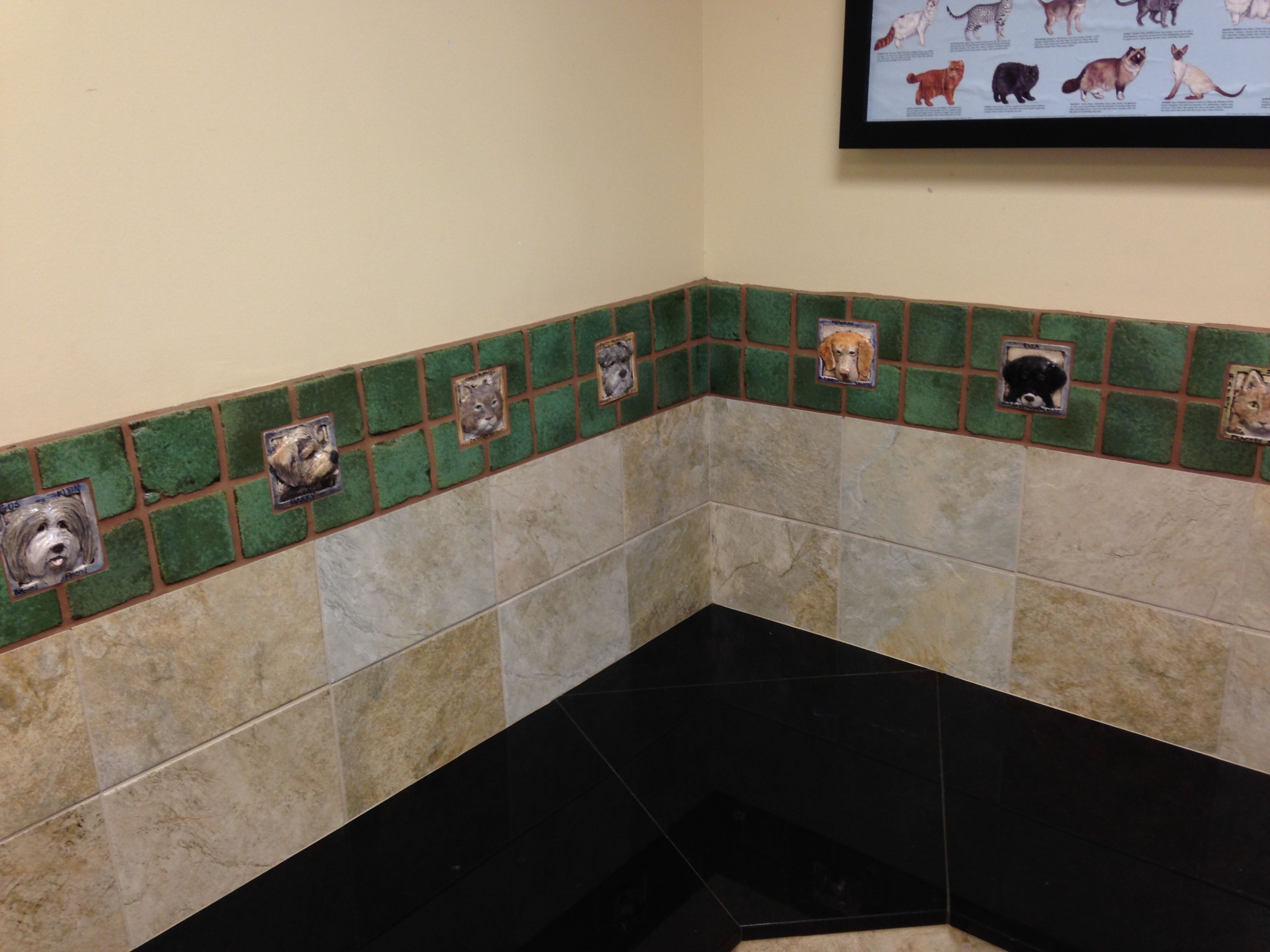 Decorative animal tiles installation at McKamey Animal