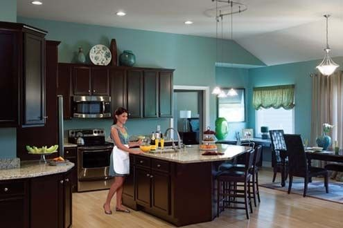 Love Dark Cabinets And The Wall Color Teal Kitchen Walls Brown Cabinets Teal Kitchen