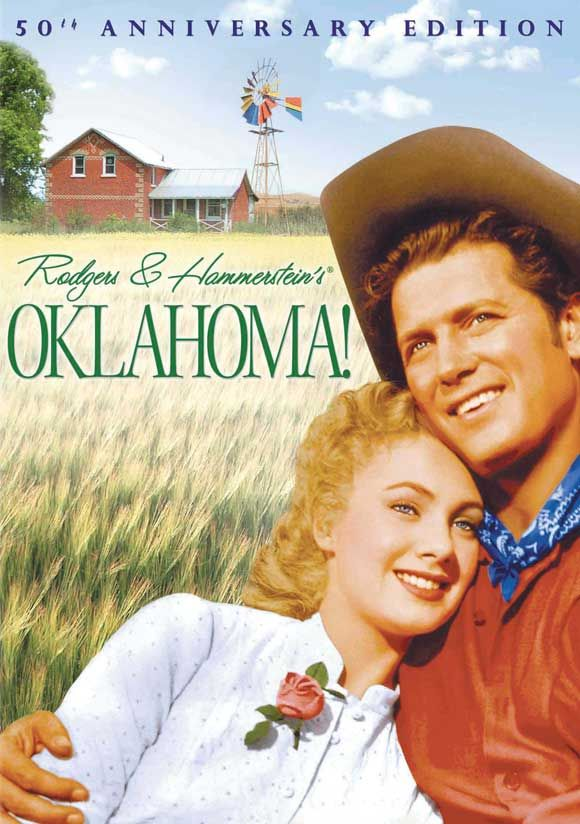 Rodgers and Hammerstein's 1943 Broadway musical was considered revolutionary for a multitude of reasons, not least of which were the play's intricate integration of song and storyline, and the simplicity and austerity of its production design. The 1955 film version of Oklahoma! retains the songs (except for Lonely Room and It's a Scandal!, which are usually cut from most stage presentations anyway) and the story, but the simplicity is sacrificed to the spectacle of Technicolor, Todd-AO, and…