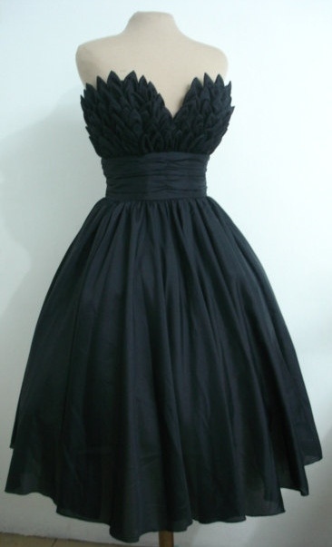 LOVE this dress. A possible celebratory purchase for my end goal.