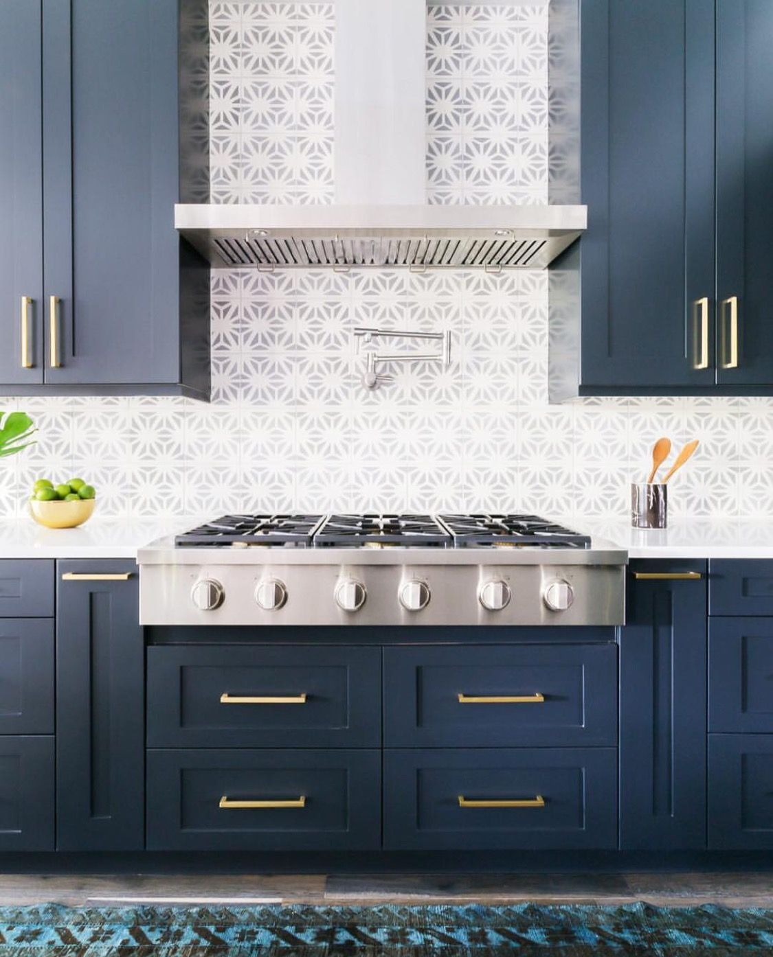 Navy blue kitchen with gray patterned tile backsplash ...
