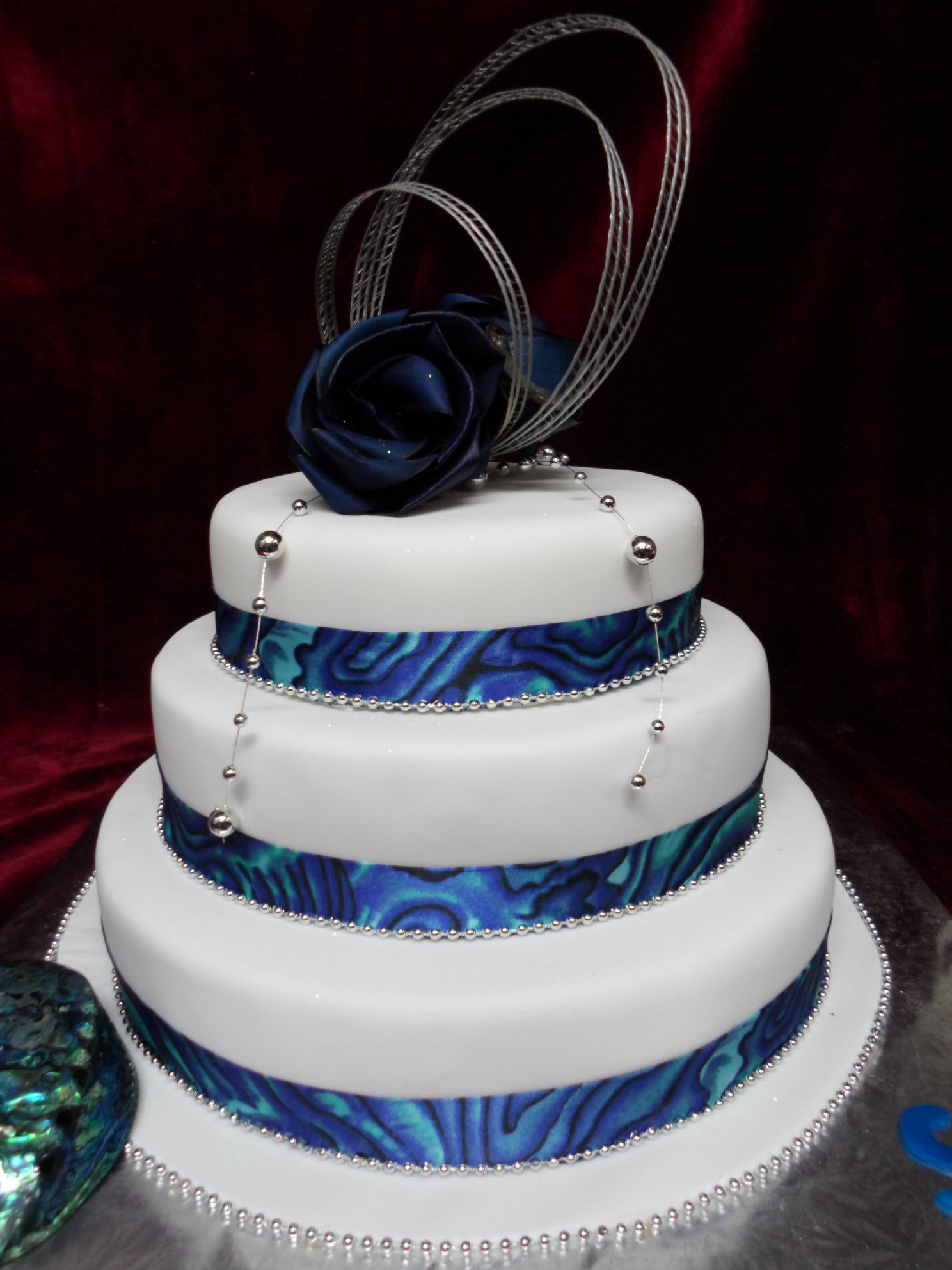 ribbon size for wedding cake 3 tier paua shell ribbon themed wedding cake fresco 19217