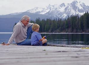 Grandpa And Grandson Fishing On A Rock In The Sunshine Beside A Babbling Stream With His Grandson Fishing Places Gone Fishing Inspirational Story