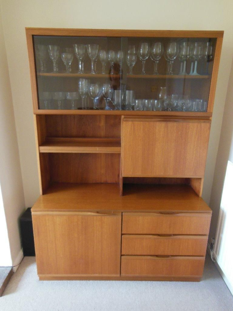 Includes Storage Cupboard And 3 Drawers, Sliding Glass Doors In Front Of Display  Shelving With Backlight, Drop Down Drinks Cupboard Door.