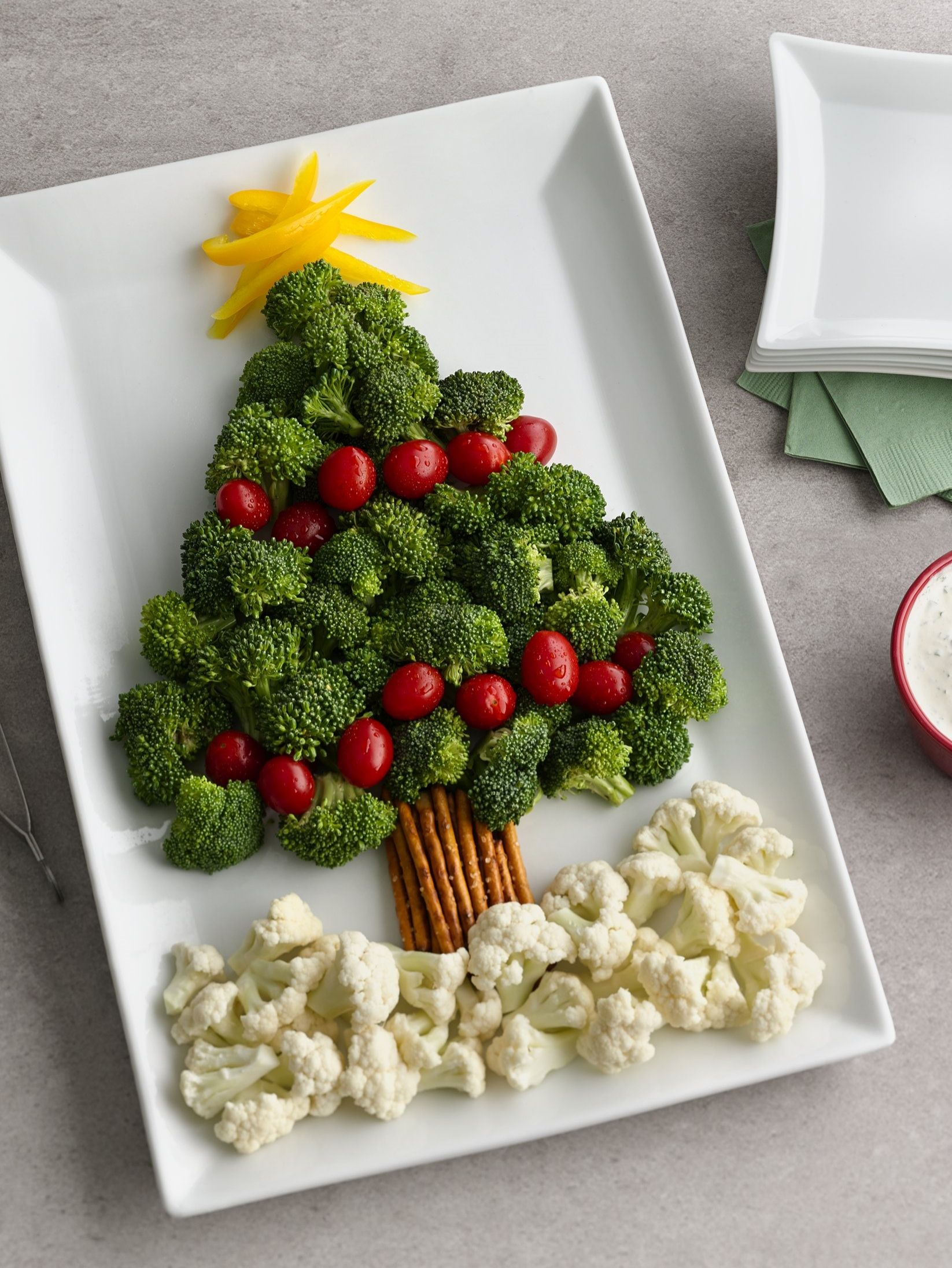 a broccoli and tomato tree with a pretzel trunk and cauliflower snow makes for a memorable and easy christmas appetizer