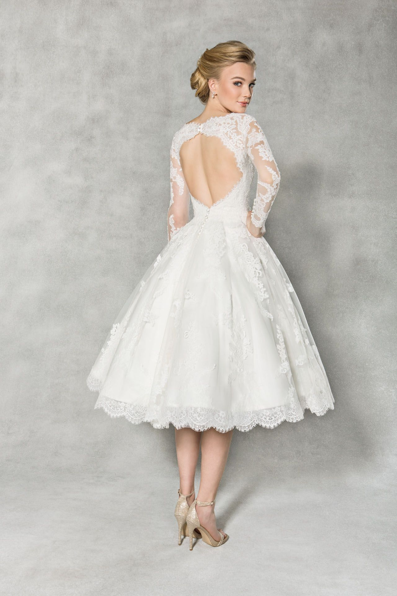 c1cd466b3d90 We think you're going to love this vintage tea length wedding dress  'Arlington'. Delicate lace adorns the sleeves, finished with a stunning  open back