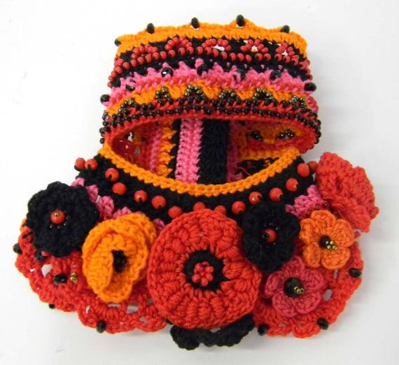 Bracelet made with technical freeform crochet. High quality cotton in the colors:black, pink fuxia,red ,orange. Fabric with glass beads and