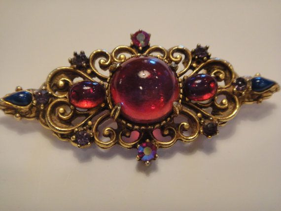 Vintage Brooch Florenza Signed Red Glass Cabachon Stones and Aged gold metal…