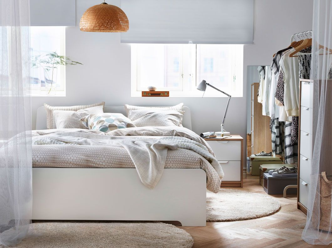 Ikea Schlafzimmer ~ A light bedroom with a big white bed completed with beige