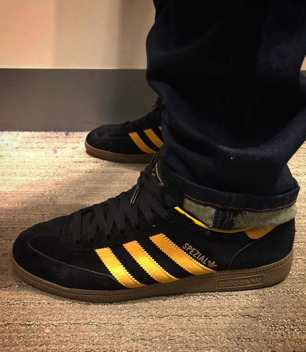pick up 3d93d 6a2aa Adidas Spezial in black and yellow on feet on the street