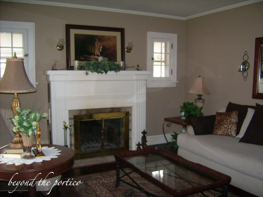 Behr studio taupe had painted both rooms a darker taupe tan color