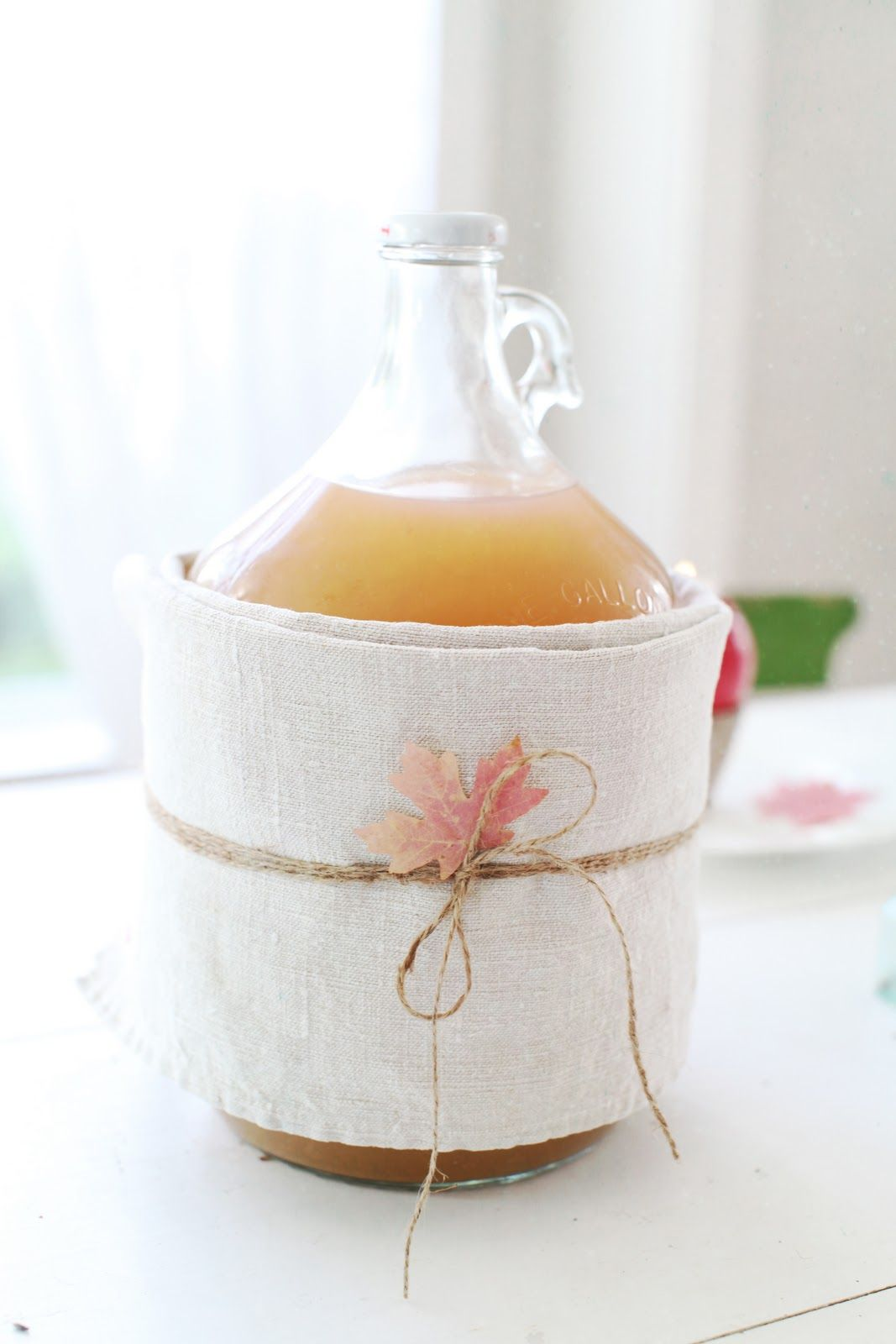 Very cute - wrap a jug of apple cider with a linen towel, twine and ...
