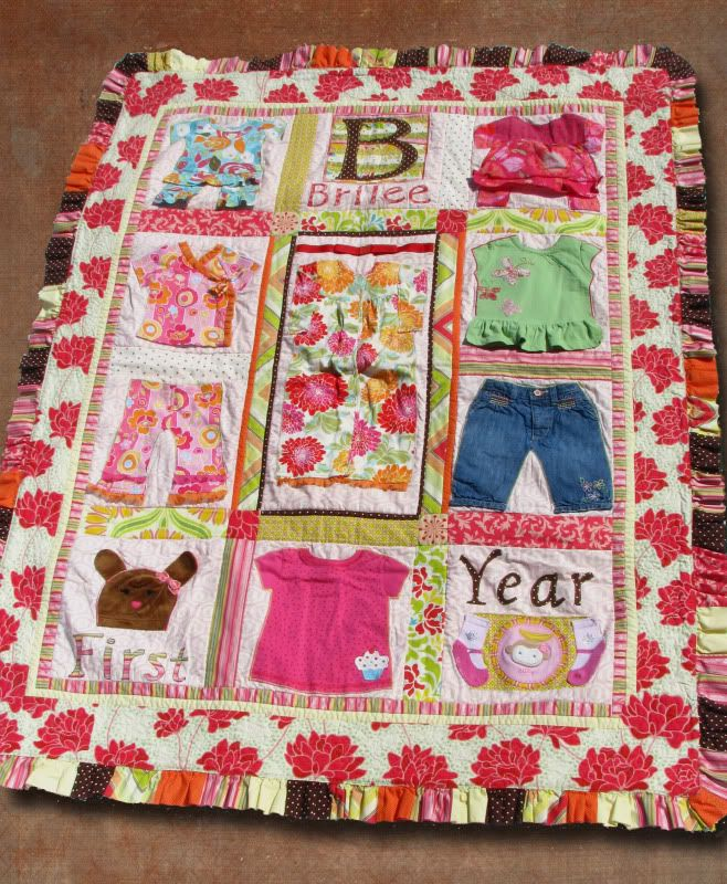 Beautiful Baby Clothes Quilt With Ruffle Binding. Found On