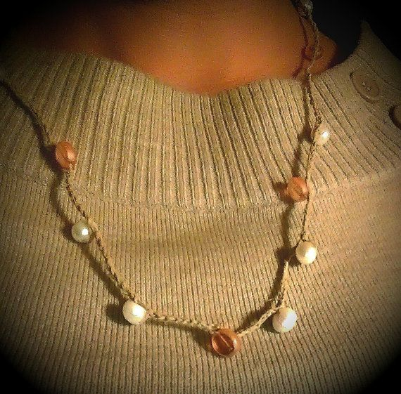 A touch of summer glow. I would probably wear this any time of the year. Hand crotchet fresh water pearl and hemp necklace by LoveSaltyAir