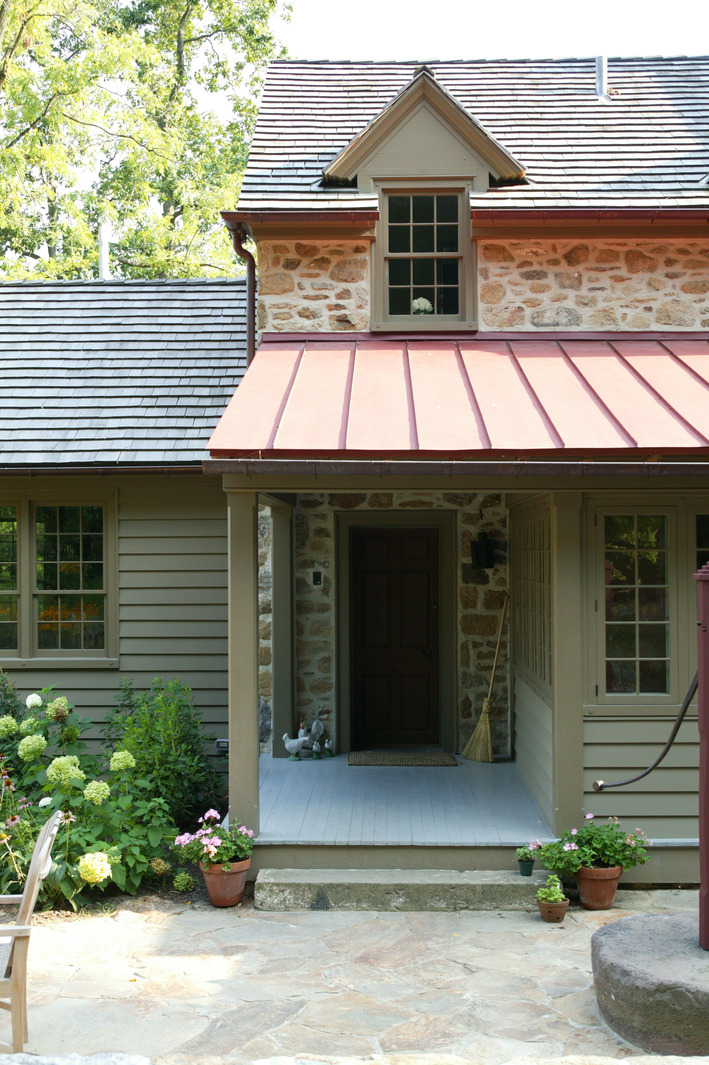 A Covered Porch With A Standing Seam Tin Roof Create A Charming