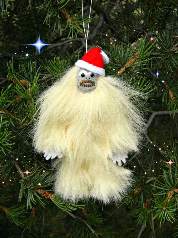 A Yeti Christmas Ornament Ivory Furry Bigfoot with Santa Hat North