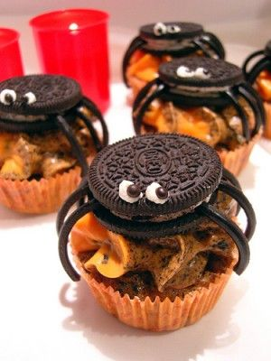 Spider Cupcakes! Regular frosted cupcakes with an Oreo body, black twizzler legs, and dashes of frosting for eyes. Cute Halloween cupcakes.