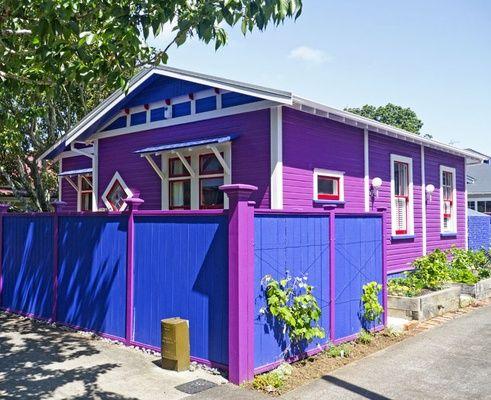 Homeowner Fiona Sheffield certainly didn't hold back when she painted her Auckland house a combination of Resene Troubadour (purple), Resene Deep Koamaru (blue), Resene Jalapeño (red) and Resene Vista White.