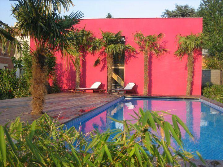 Bart & Pieter | Tuinarchitectuur - gemeenschappelijke tuin met tropische inslag