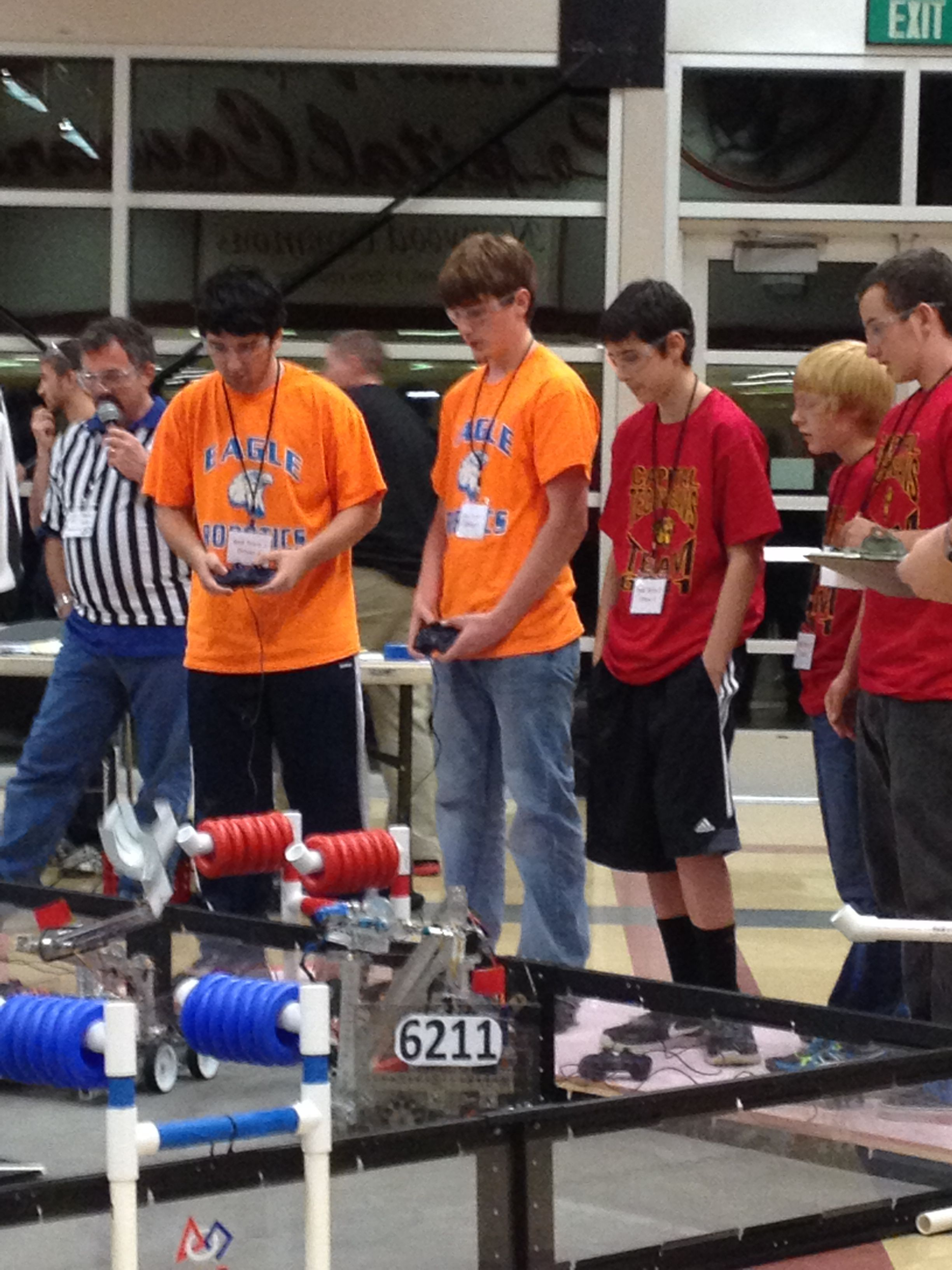Teams try to use their robots to grab red rings at the FTC