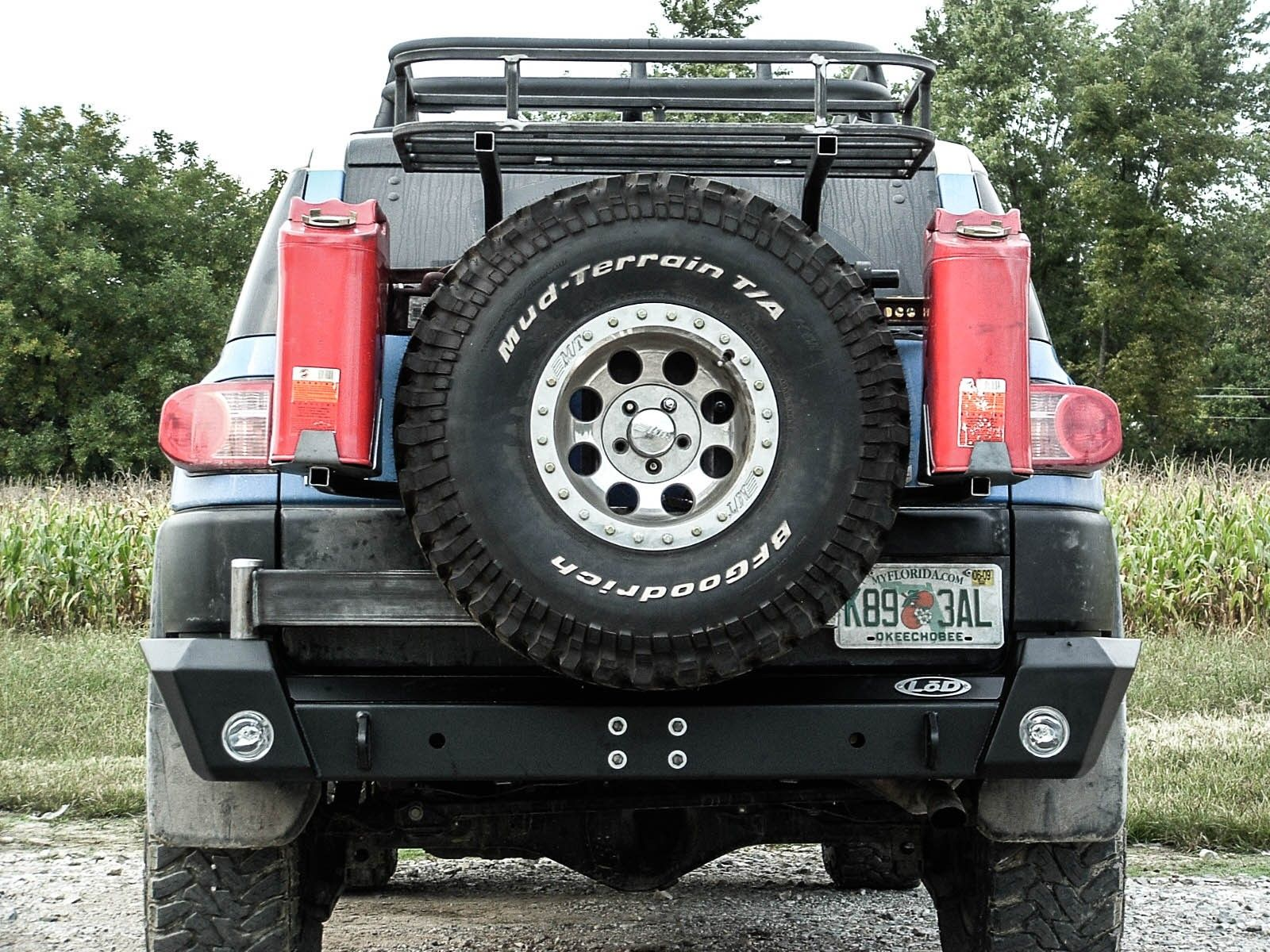 Toyota Fj Cruiser Tire Carrier Rear Bumpers Tire Carriers Fj Cruiser Toyota Products In 2020 Fj Cruiser Toyota Fj Cruiser Fj Cruiser Accessories