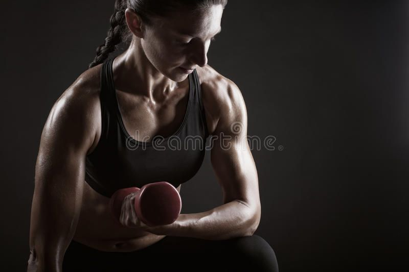 Fitness woman. Doing workout with weights on dark background , #Aff, #workout, #woman, #Fitness, #ba...