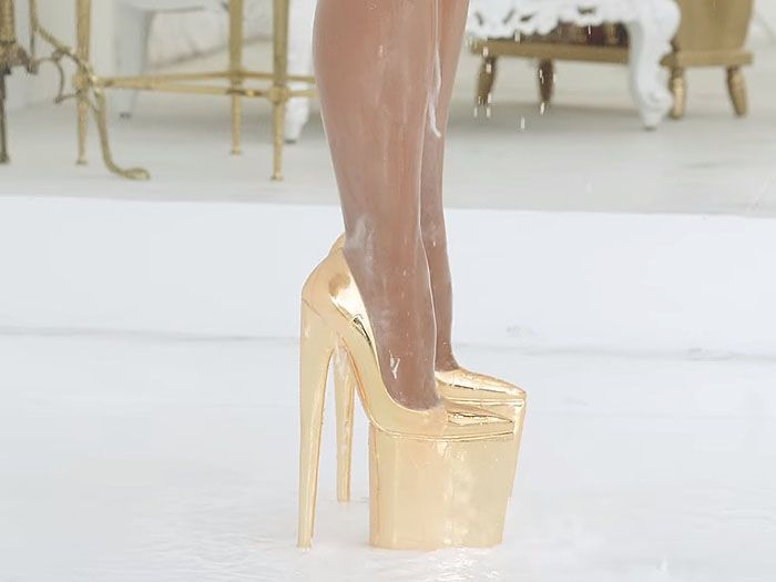 Kim Kardashian wearing Brian Atwood platform pumps that have insane 10-inch  heels and are reportedly made of 18-karat gold!