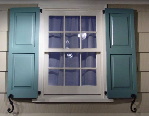 Dusty teal shutters with beige exterior home for Should plantation shutters match trim
