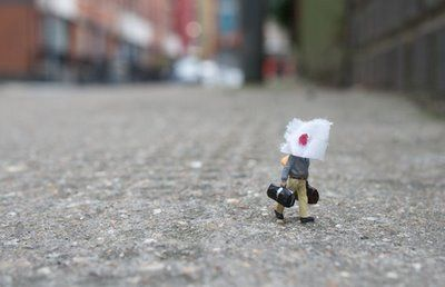 Little People - A tiny street art project. Little hand painted people left in London to fend for themselves. by Slinkachu.
