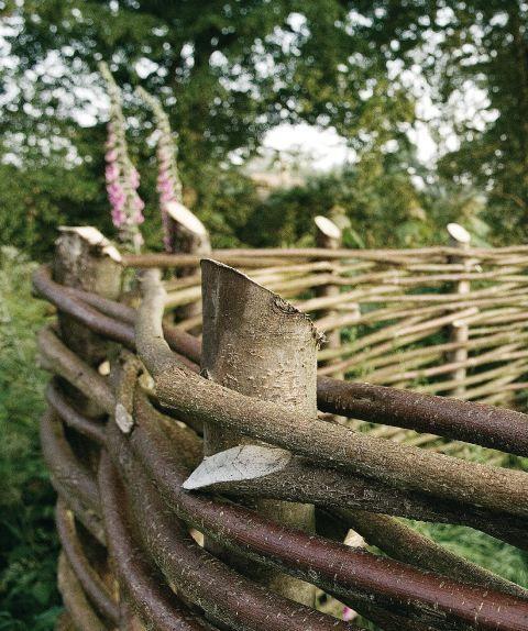 Woven hazel & sweet chestnut fence at Walnuts Farm