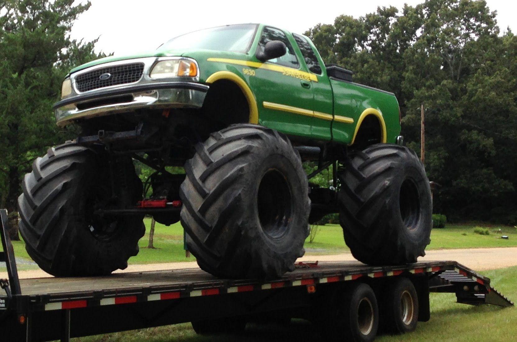 Monster mud trucks john deere monster truck bog truck mud bigfoot tractor tires huge