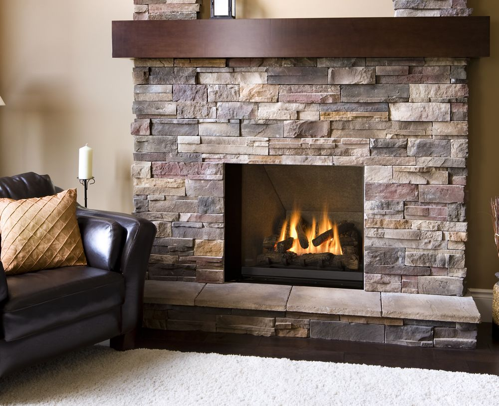natural stone veneer firepalce with dark wood mantel | home decor