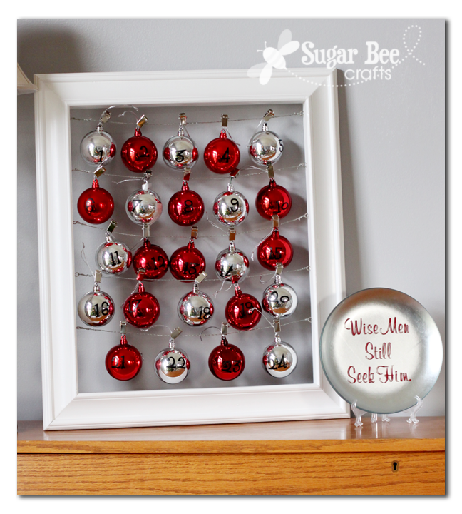 Advent Calendar - using fillable plastic ornaments.  This would also be great to display small pictures on the clips, etc...